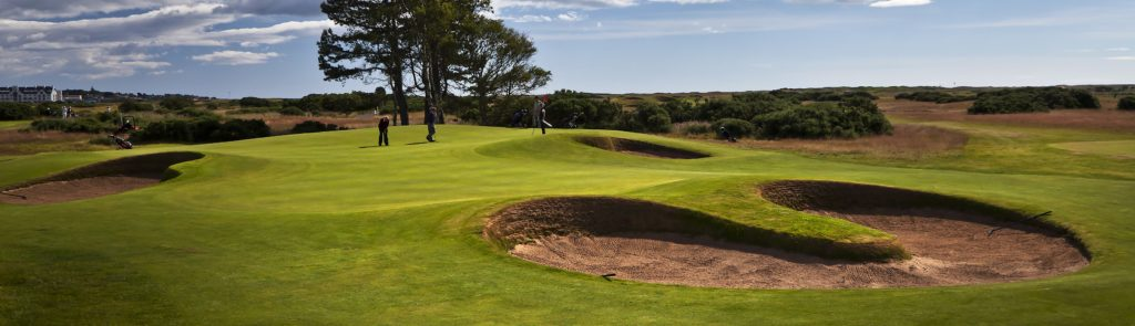 Panoramic view of the golf grounds and bunkers or sandtraps on the Championship Course at Carnoustie Golf Links. Hole 13.